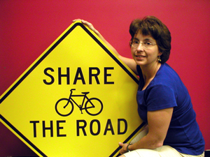Deb Dauphinais with a Share the Road CT sign